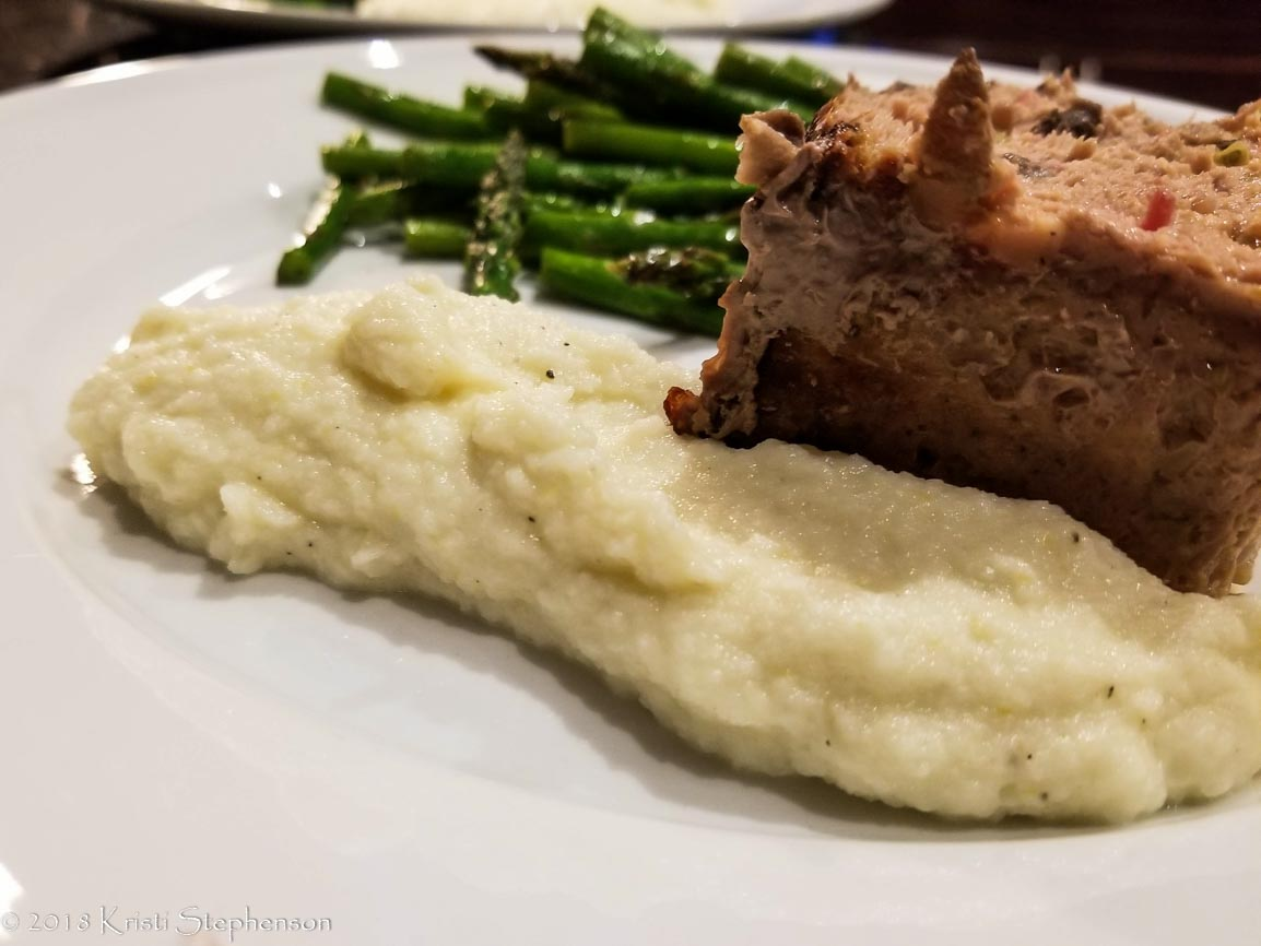 Cauliflower mash served with meatloaf and asparagus