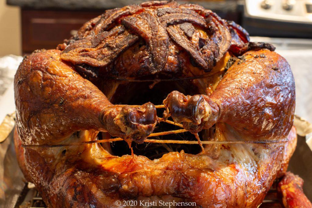 Whole smoked turkey, drumstick angle