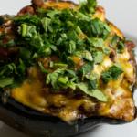 Pinterest image showing taco-stuffed acorn squash.