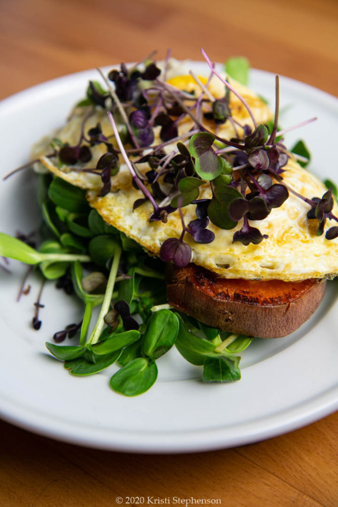 micro greens on eggs on sweet potato rounds