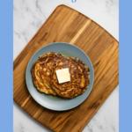 Pinterest image showing oatmeal sourdough pancakes.